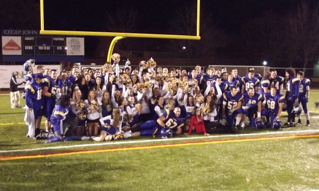 John Abbott Islanders and cheerleaders celebrate after qualifying for the playoffs